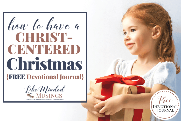 happy girl with present How to Have a Christ Centered Christmas LikeMindedMusings