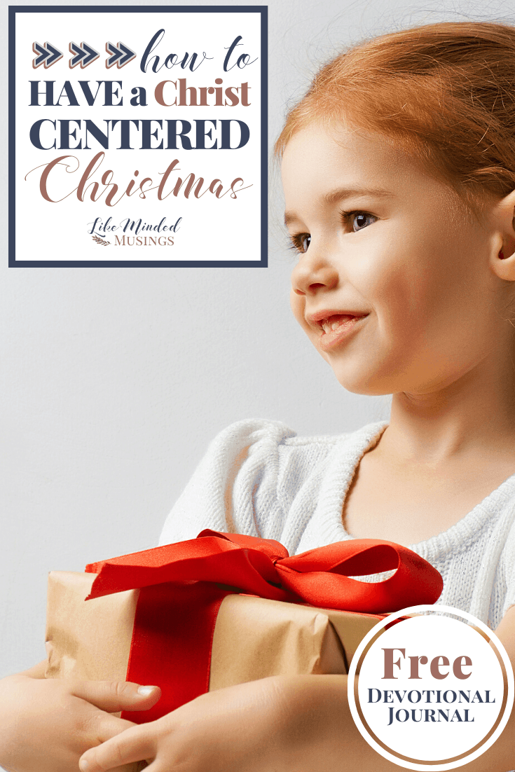 Happy girl with present How to Have a Christ Centered Christmas on LikeMindedMusings